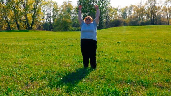 Thumbnail for Sport - Overweight Woman Exercising On Meadow