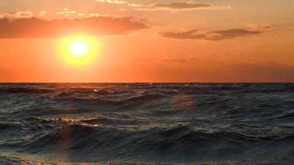 Thumbnail for Golden Sunset Over Rough Sea