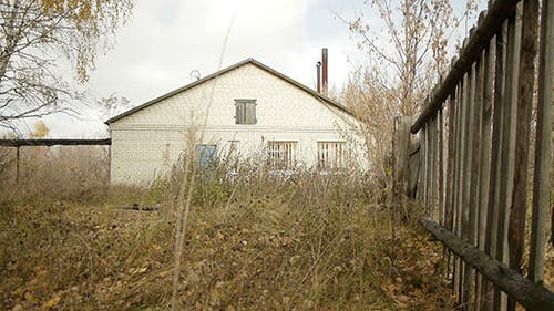 Wooden Fence And Abandoned Village Building