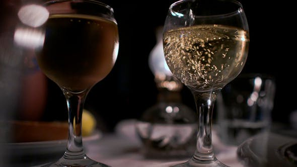 Thumbnail for Pouring Wine Into Empty Glass In Restaurant