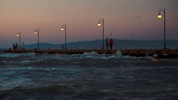 Thumbnail for People On Pier In The Windy Evening