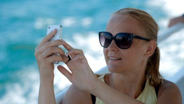 Thumbnail for Woman Making Selfie With Smatphone On The Boat
