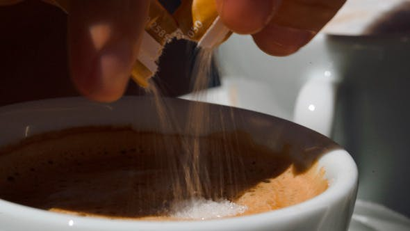 Thumbnail for Putting  Sugar Into Cup With Coffee