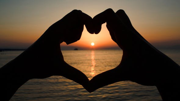 Thumbnail for Sunset Over Sea In Heart Made Of Hands