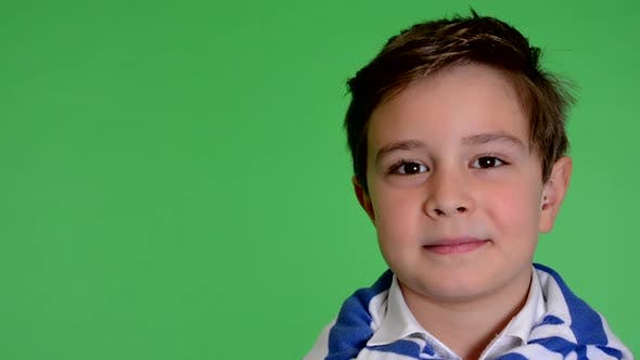 Thumbnail for Young Handsome Child Boy Smiles To Camera - Green Screen - Closeup - Studio
