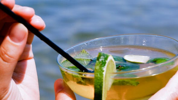 Thumbnail for Drinking Mojito With Straw