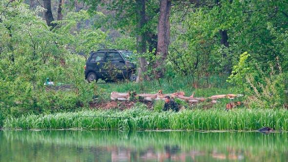 Thumbnail for Fishing Men On Lake At Rain