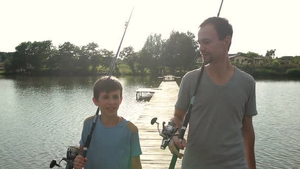 Thumbnail for Happy Dad and Son with Rods Going Fishing on Pond