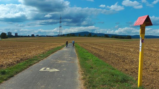 Thumbnail for People with Bicycle in the Field
