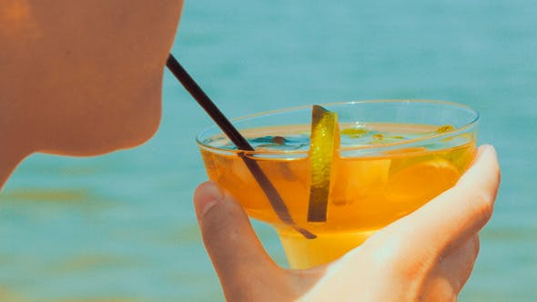 Thumbnail for Woman Drinking Refreshing Cocktail With A Straw
