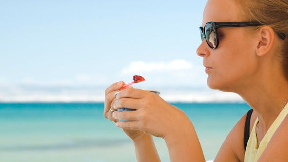 Thumbnail for Woman Eating Ice-Cream On The Beach