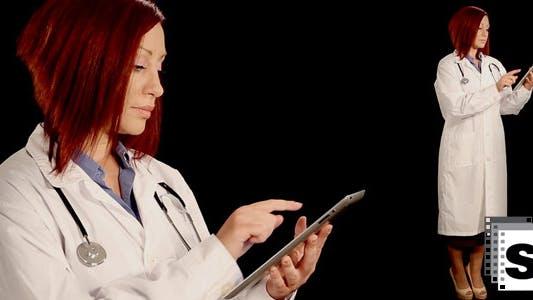 Thumbnail for Doctor Using Digital Tablet