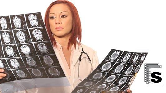Thumbnail for Doctor Examining MRI (female)
