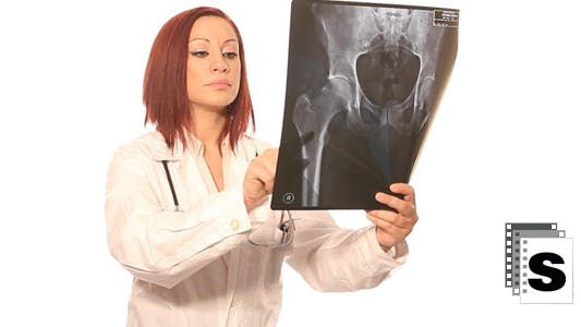 Cover Image for Female Doctor Examining  X-Ray