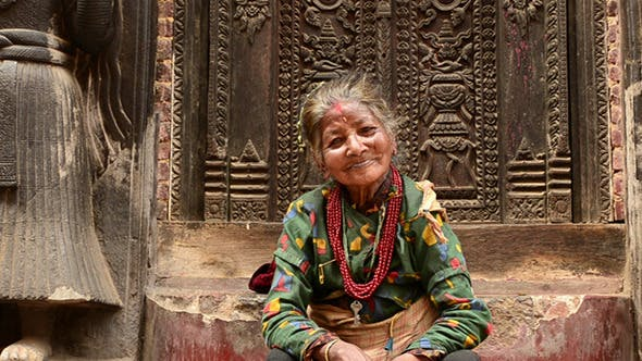 Thumbnail for Old Woman On Steps Of Temple