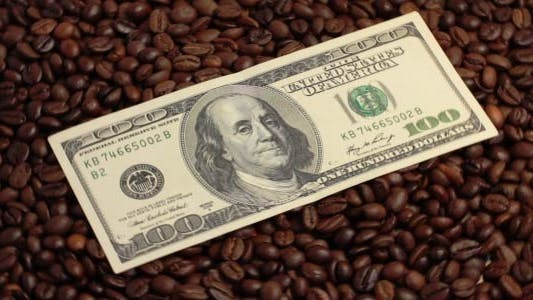 Thumbnail for Rotating Coffee Beans And U.S. Dollars 1