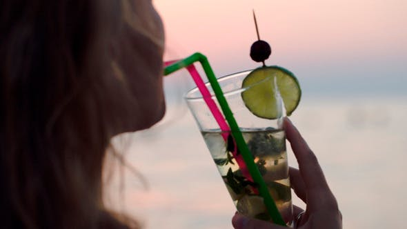 Thumbnail for Woman Drinking Mojito With A Straw