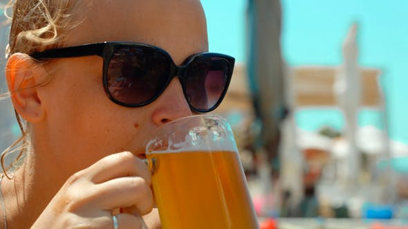 Thumbnail for Young Woman Drinking Cold Beer On A Hot Day