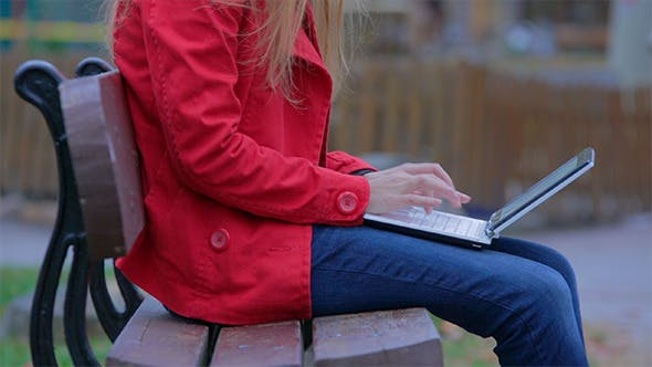 Thumbnail for Woman Working on the Laptop in the Park