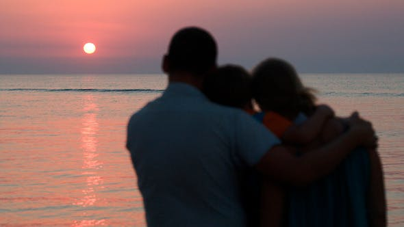 Thumbnail for Family Of Three Watching Sunset Over Sea