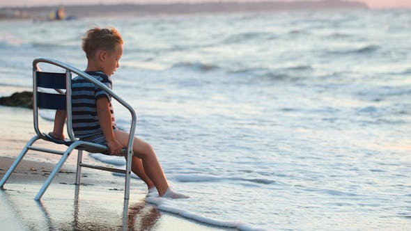 Thumbnail for Boy Sitting On The Chair By Sea