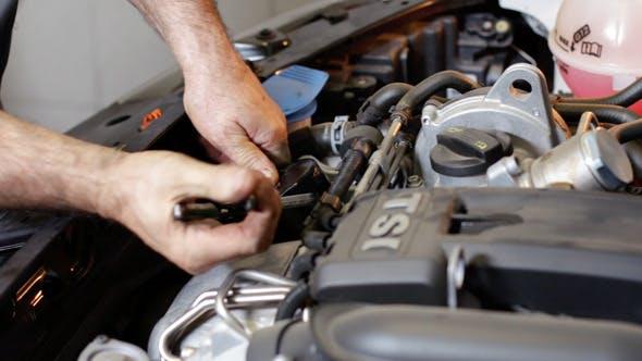 Thumbnail for Car Repair Removing the Oil Filter