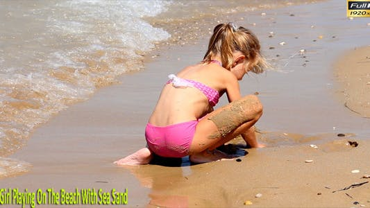 Thumbnail for Little Girl Playing On The Beach With Sea Sand
