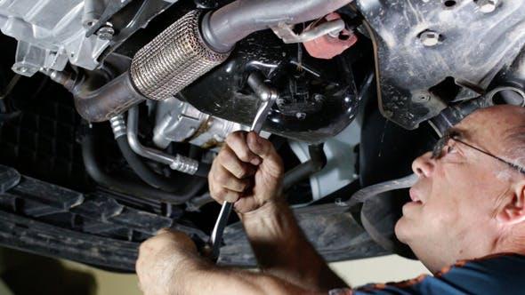 Thumbnail for Car Repair Mechanic Removing the Oil Cap