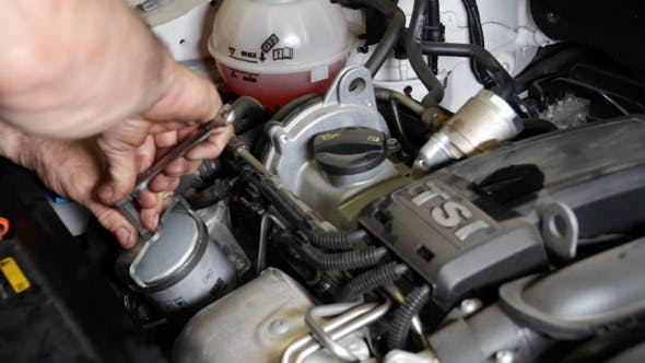 Thumbnail for Car Repair Mounting the Oil Filter