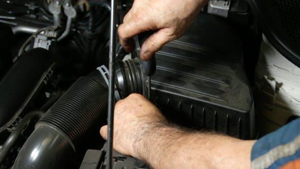 Thumbnail for Car Repair Mechanic Screwing Automobile Air Filter