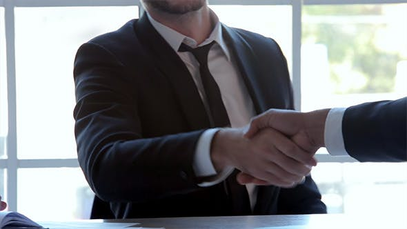 Cover Image for Three Businessmen Handshake