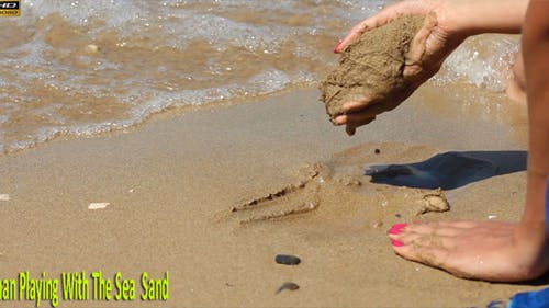 Woman Playing With The Sea Sand