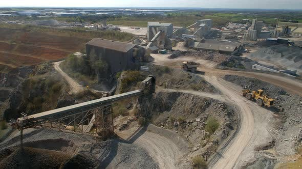 A Huge Dump Truck Taking Ore to a Refinery in a Quarry