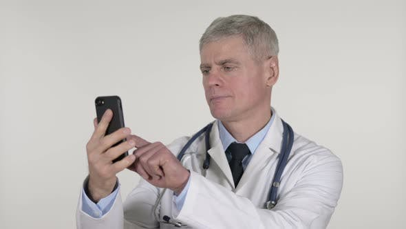 Thumbnail for Senior Doctor Browsing Smartphone on White Background