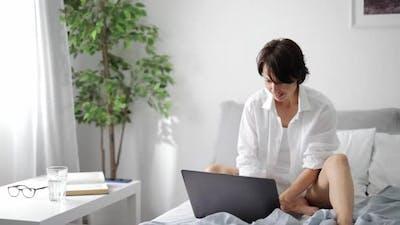 Writer Typing on Laptop