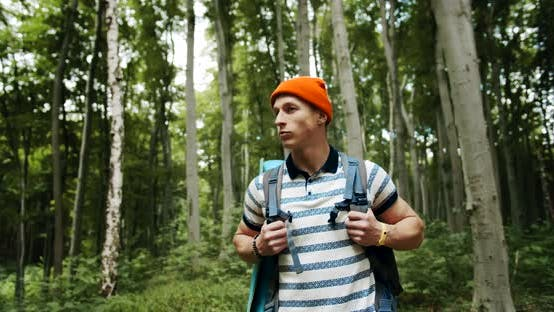 Thumbnail for Backpacked Male Walking in Forest
