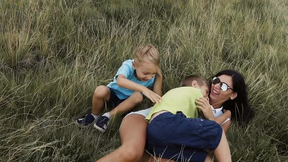 Children Play with Mom in the Mountains a Fun Family