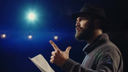 Actor Performing a Monologue in a Theater