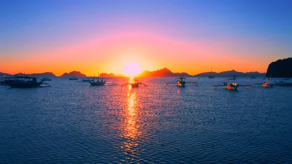 Cover Image for Sail Boats at Sunset on the Sea Lagoon on Corong Beach in El Nido, Palawan, Philippines