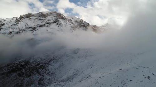 Foggy Snowy Mountains
