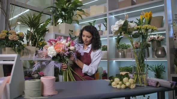 Thumbnail for Skillful Florist Finishing Bouquet Composition