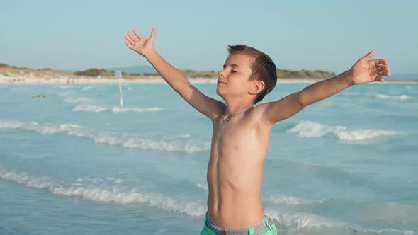 Carefree Boy Enjoying Summer at Seashore