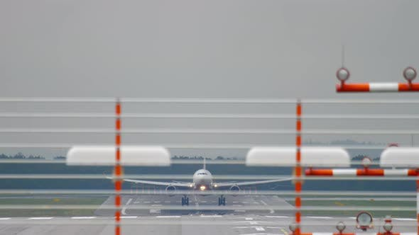 Cover Image for Airplane Landing at Wet Weather