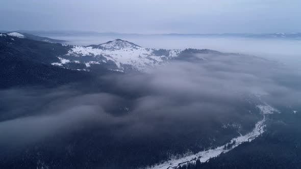 Aerial View in Sunrise Winter Mountain