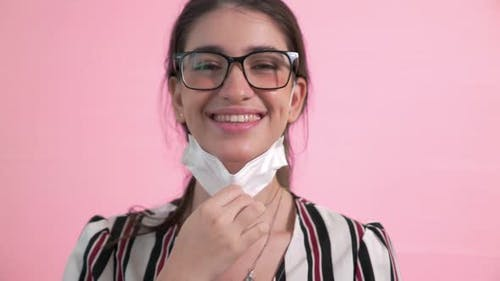 Young Woman Take Off Face Mask Removing From Face