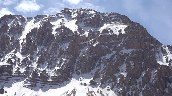 Thumbnail for Rocky Snowy Dome Mountain Summit in Sunny Spring Day
