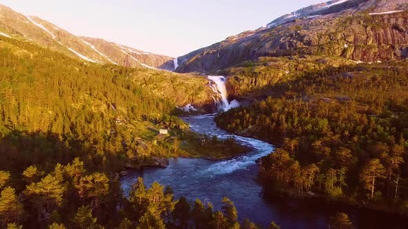 Thumbnail for Aerial View of Rapid Stunning Waterfall in Husedalen Valley, Norway. Summer Time.