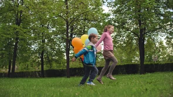 Thumbnail for Carefree Children Running in Park