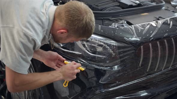 Thumbnail for Close Up of Paint Protection Film Installation on Modern Luxury Car
