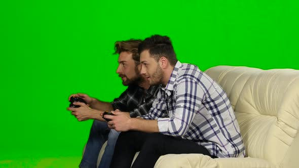 Thumbnail for Men Play on the Console in the Same Team. Green Screen